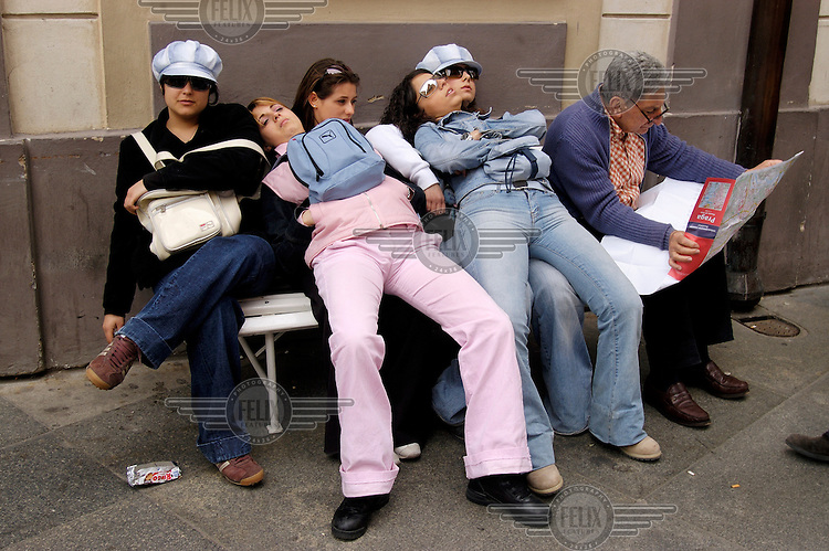 Tired tourists taking a break in Prague Castle.