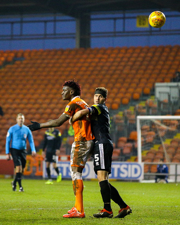 Shrewsbury Town's Mat Sadler holds Blackpool's Armand Gnanduillet<br /> <br /> Photographer Alex Dodd/CameraSport<br /> <br /> The EFL Sky Bet League One - Blackpool v Shrewsbury Town - Saturday 19 January 2019 - Bloomfield Road - Blackpool<br /> <br /> World Copyright © 2019 CameraSport. All rights reserved. 43 Linden Ave. Countesthorpe. Leicester. England. LE8 5PG - Tel: +44 (0) 116 277 4147 - admin@camerasport.com - www.camerasport.com