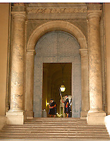 Members of the Swiss Guard keep watch at an entrance to St. Peter's Basilica in Rome, Italy March 2, 2006. (Photo by Alan Greth)