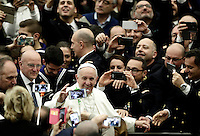 Papa Francesco saluta i fedeli al suo arrivo all'udienza generale del mercoledi' in aula Paolo VI in Vaticano, 25 gennaio 2017.<br /> Pope Francis waves faithful as he arrives to lead  his weekly general audience in Paul VI Hall at the Vatican, on January 25, 2017.<br /> UPDATE IMAGES PRESS/Isabella Bonotto<br /> STRICTLY ONLY FOR EDITORIAL USE