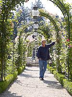 Fawaz Gruosi stands in the rose allee in the garden of his villa overlooking Lake Geneva