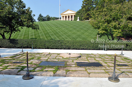 """Arlington, VA - August 27, 2009 -- Wide view of the markers and eternal flame at the grave of United States President John F. Kennedy at Arlington National Cemetery in Arlington, Virginia on Thursday, August 27, 2009.  The markers from let to right are Patrick Bouvier Kennedy, President Kennedy, first lady Jacqueline Bouvier Kennedy Onassis, and """"daughter""""..Credit: Ron Sachs / CNP.(RESTRICTION: NO New York or New Jersey Newspapers or newspapers within a 75 mile radius of New York City)"""