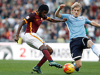 Calcio, Serie A: Roma vs Lazio. Roma, stadio Olimpico, 8 novembre 2015.<br /> Roma's Gervinho, left, kicks to score as Lazio's Dusan Basta tries to stop him during the Italian Serie A football match between Roma and Lazio at Rome's Olympic stadium, 8 November 2015.<br /> UPDATE IMAGES PRESS/Isabella Bonotto