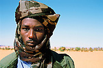 Gouro, Chad. A Tubu tribesman wears military camoflauge turban and jacket.