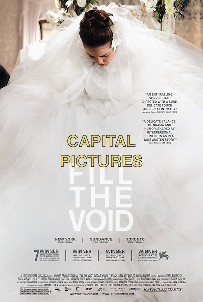 AMERICAN POSTER ART<br /> in Fill the Void (2012) <br /> (Lemale et ha'halal)<br /> *Filmstill - Editorial Use Only*<br /> CAP/FB<br /> Supplied by Capital Pictures