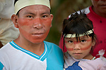Their faces painted red with urucum, a father and daughter participate in a march by indigenous people through the streets of Atalaia do Norte in Brazil's Amazon region on March 27, 2019. They were protesting a central government plan to turn control of health care over to municipalities, in effect destroying a federal program of indigenous health care. Indian rights activists are worried that the government of President Jair Bolsonaro is reducing or eliminating protections for the country's indigenous people.