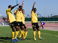 Jason Wright (10) of Jamaica celebrates his goal with teammates during the quarterfinals of the CONCACAF Men's Under 17 Championship at Catherine Hall Stadium in Montego Bay, Jamaica. Jamaica defeated Honduras, 2-1.