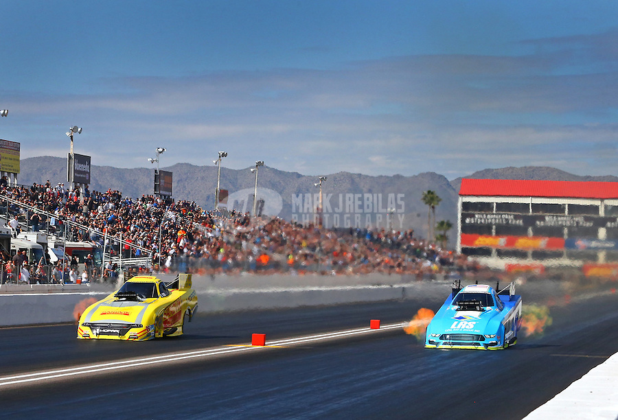 Feb 26, 2017; Chandler, AZ, USA; NHRA funny car driver Matt Hagan (left) defeats Tim Wilkerson during the Arizona Nationals at Wild Horse Pass Motorsports Park. Mandatory Credit: Mark J. Rebilas-USA TODAY Sports