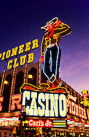 The neon cowboy and Casinos with Neonlights in Las Vegas gambling city in Nevada, USA