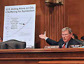 "Washington, DC - July 7, 2009 -- United States Senator Jim Inhofe (Republican of Oklahoma) points to a chart as he questions a witness during the U.S. Senate Committee on Environment and Public Works hearing entitled, ""Moving America toward a Clean Energy Economy and Reducing Global Warming Pollution: Legislative Tools."" in Washington, D.C. on Tuesday, July 7, 2009. The legislation being considered is known as a cap-and-trade bill that would place mandatory limits on the emissions of the greenhouse gases that are said to cause global warming..Credit: Ron Sachs / CNP"