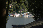 View of boats at anchor and homes in Deep Cove,Vancouver, British Columbia, Canada.