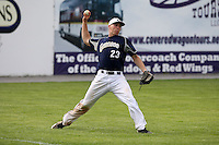 April 15,2010:  Left Fielder Jacob Featherstone (23) of the Genesee Community College (GCC) Cougars Men's Baseball Team makes a play in the field vs. Alfred State at Dwyer Stadium in Batavia, NY.  Photo Copyright Mike Janes Photography 2010