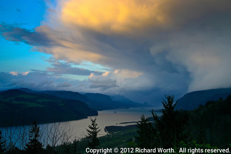 Sunset paints a cloudbank orange over the Columbia River in Oregon.