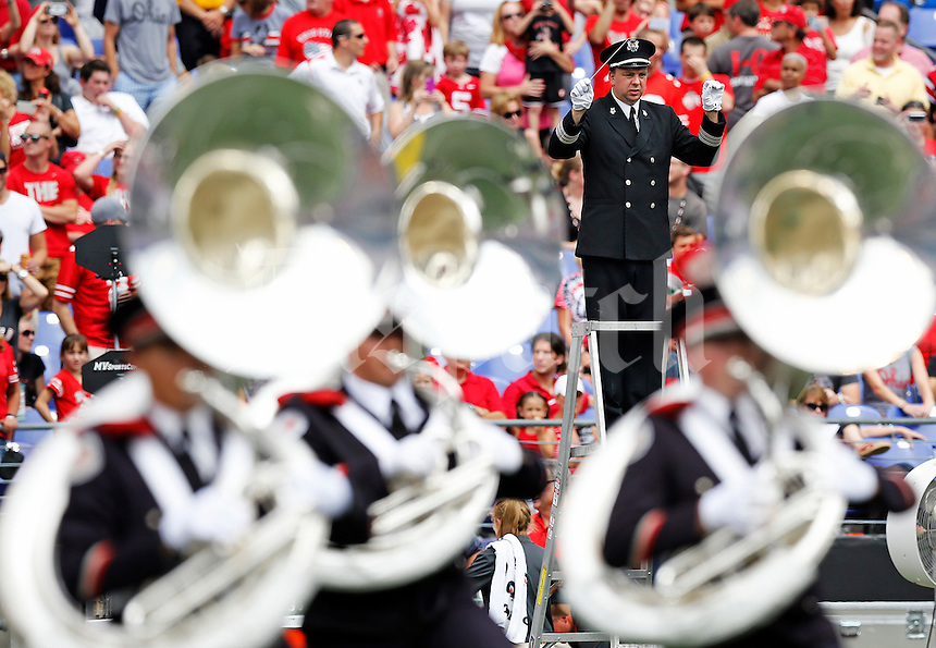 Christopher Hoch leads the Ohio State Marching Band during half time of the college football game between the Ohio State Buckeyes and the Navy Midshipmen at M&T Bank Stadium in Baltimore, Saturday afternoon, August 30, 2014. The Ohio State Buckeyes defeated the Navy Midshipmen 34 - 17. (The Columbus Dispatch / Eamon Queeney)