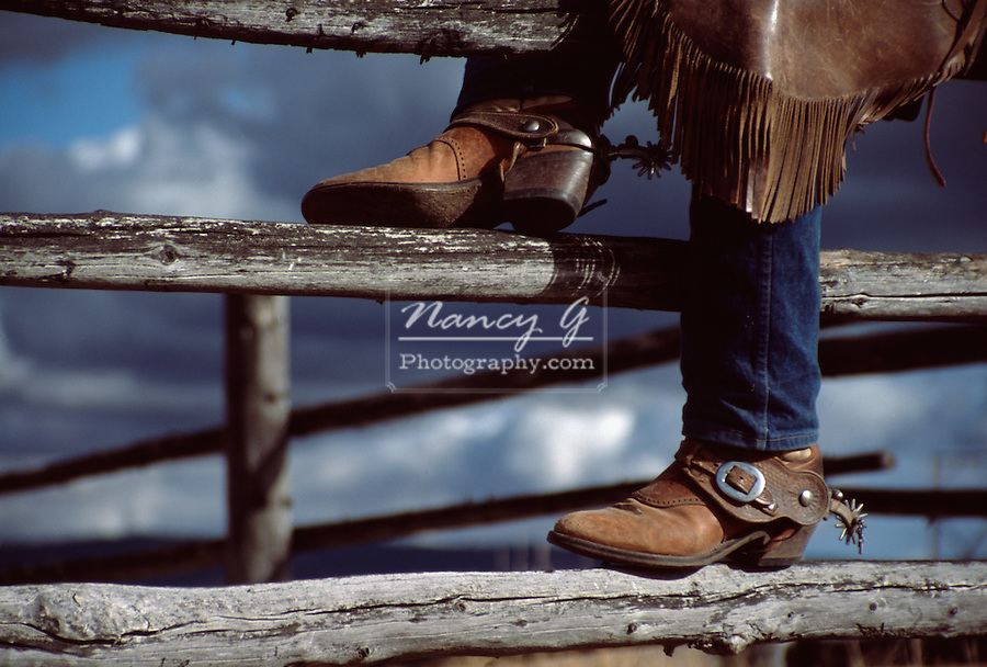 Cowboy boots on ranch fence in Central Oregon