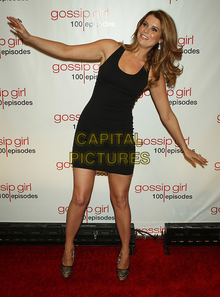 Joanna Garcia Swisher.The 'Gossip Girl' 100th Episode Celebration at Cipriani Wall Street, New York, NY, USA..November 19th, 2011.full length black sleeveless dress hands arms bending leaning funny .CAP/LNC/TOM.©LNC/Capital Pictures.