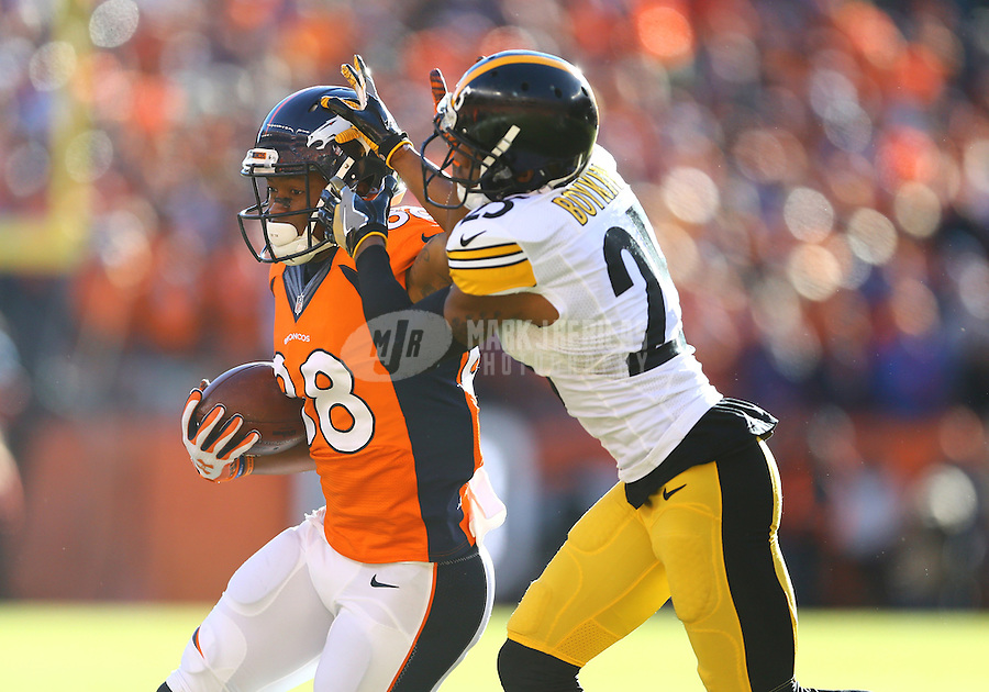 Jan 17, 2016; Denver, CO, USA; Denver Broncos wide receiver Demaryius Thomas (88) stiff arms Pittsburgh Steelers defensive back Brandon Boykin (25) during the first quarter of the AFC Divisional round playoff game at Sports Authority Field at Mile High. Mandatory Credit: Mark J. Rebilas-USA TODAY Sports