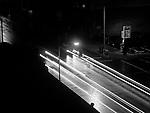 Street scene with light streaks at night eerie feeling downtown