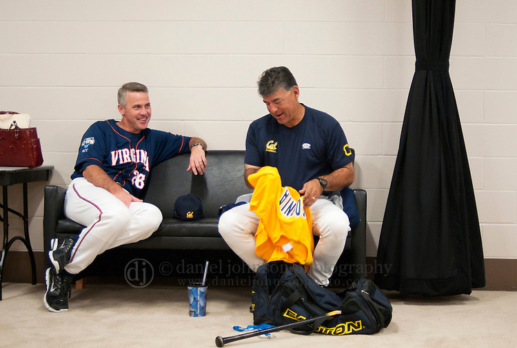 17 June 2011  -- David Esquer California Berkeley Baseball. University of California Berkeley baseball coach David Esquer, right, talks with Virginia head coach Brian O'Connor before a College World Series press conference during the opening day celebrations on Friday, June 17 at TD Ameritrade Park Omaha for the College World Series in Omaha, Nebraska. PHOTO/Daniel Johnson (Copyright 2011 Daniel Johnson)