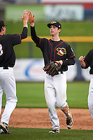 Quad Cities River Bandits center fielder Kyle Tucker (19) high fives Connor Goedert (8) after a game against the Burlington Bees on May 9, 2016 at Modern Woodmen Park in Davenport, Iowa.  Quad Cities defeated Burlington 12-4.  (Mike Janes/Four Seam Images)