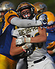 Jack Raia #38 of Bethpage fights for yards before being brought down by Christian Rodas #9 of Lawrence in the third quarter of a Nassau County Conference III varsity football game at Lawrence High School on Saturday, Oct. 7, 2017.