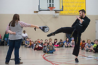 NWA Democrat-Gazette/BEN GOFF @NWABENGOFF<br /> Kimberly Manley, a 'team mom,' and Chandler Fordham, an instructor from PRO Martial Arts in Rogers, demonstrate a kick during a physical education period for kindergarten through 2nd grade students Thursday, Feb. 22, 2018, during the biweekly 'social day' meeting of the Social Homeschoolers Network of Northwest Arkansas at the First Baptist Church of Rogers Olive Street Campus.