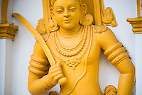 Ancient City of Anuradhapura, Sri Maha Bodhi, gold statue close up in the Mahavihara (The Great Monastery), Sri Lanka, Asia. This is a photo of Sri Maha Bodhi at the Mahavihara, aka the Great Monastery in the Ancient City of Anuradhapura, a complex of ancient Buddhist temple ruins. The Ancient City of Anuradhapura is a UNESCO World Heritage Site in an area known as the Cultural Triangle of Sri Lanka.
