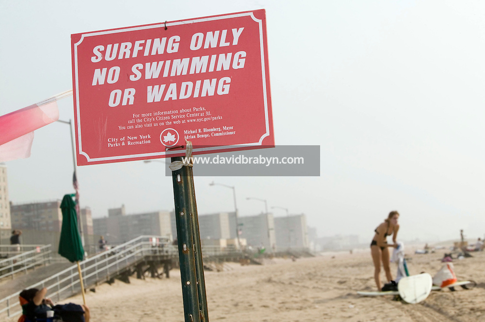 A surfer gets ready in the surfing only section of Far Rockaway beach in New York, United States, 17 September 2005. Photo Credit: David Brabyn.