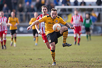 Danny Holmes of Newport County passes back to goal during the Sky Bet League 2 match between Newport County and Accrington Stanley at Rodney Parade, Newport, Wales on 28 March 2016. Photo by Mark  Hawkins.