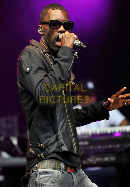 Wretch 32 (Jermaine Scott).Camp Bestival at Lulworth Castle & Park, Dorset, England..July 31st 2011.stage concert live gig performance music half length black leather jacket singing sunglasses shades  .CAP/ROS.©Steve Ross/Capital Pictures