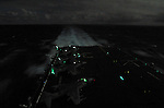 As the USS Belleau-Wood makes her way from San Diego to Hawaii on a bright night lit by the full moon, the 11th's Harrier strike aircraft are brought to life ahead of night flight operations.