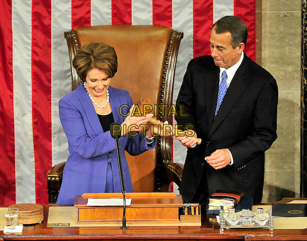 United States House Democratic Leader Nancy Pelosi (Democrat of California), left, hands the gavel to the re-elected Speaker of the U.S. House of Representatives John A. Boehner (Republican of Ohio), right, during the Opening Session of the 113th United States Congress in the U.S. Capitol in Washington, D.C. on Thursday, January 3, 2013.   .CAP/ADM/CNP.©Ron Sachs/CNP/AdMedia/Capital Pictures.