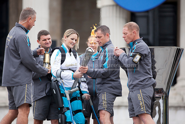 24/08/2012. LONDON, UK. Claire Lomas holds the Paralympic Torch  as she prepares to light the Paralympic Cauldron in Trafalgar Square today (24/08/12). Ms Lomas, formerly a horse event rider, was paralysed from the chest down after being injured during the Osberton Horse Trials and, with the aid of her robotic suit, completed the London Marathon in 2012. Photo credit: Matt Cetti-Roberts