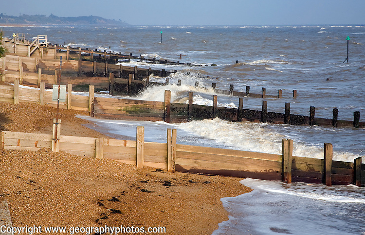 Wooden groynes and waves, Felixstowe, Suffolk, England