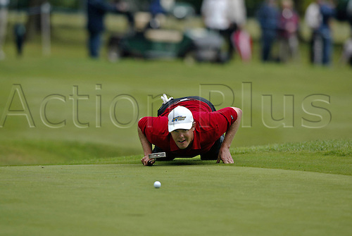 30 May 2004: Joakim Haeggman (SWE) lines up his putt on the 11th green during the final round of The Volvo PGA Championship, Wentworth, England. Photo: Glyn Kirk/Actionplus...040530  golf golfer player