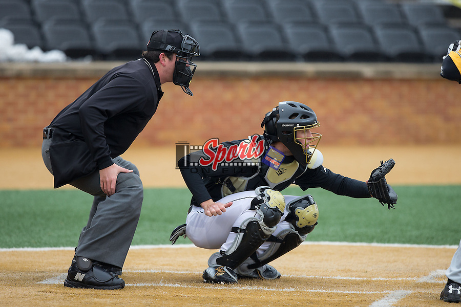 Wake Forest Demon Deacons catcher Nick Bisplinghoff (39) sets a target as home plate umpire Drew Maher looks on during the game against the Towson Tigers at Wake Forest Baseball Park on March 1, 2015 in Winston-Salem, North Carolina.  The Demon Deacons defeated the Tigers 15-8.  (Brian Westerholt/Sports On Film)