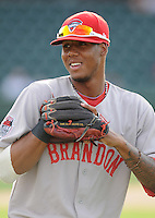 Infielder Michael Almanzar (17) of the Greenville Drive, Class A affiliate of the Boston Red Sox, prior to a game against the Charleston RiverDogs on July 31, 2011, at Fluor Field at the West End in Greenville, South Carolina. The Drive wore throwback jerseys honoring the textile mill baseball teams. (Tom Priddy/Four Seam Images)