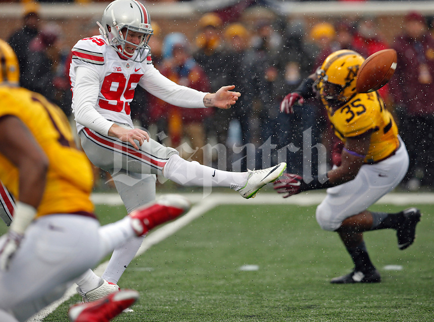 Ohio State Buckeyes punter Cameron Johnston (95) punts the ball against Minnesota Golden Gophers during the 2nd quarter at TCF Bank Stadium in Minneapolis, Minn. on November 15, 2014.  (Dispatch photo by Kyle Robertson)