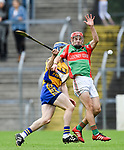 Seadna Morey of Sixmilebridge in action against Michael Corry of  Clooney-Quin during their senior county final at Cusack Park. Photograph by John Kelly.