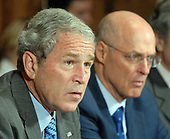 United States President George W. Bush (L), with Treasury Secretary Henry Paulson seated nearby, speaks to the media regarding the economy prior to a Cabinet meeting in the Cabinet Room of the White House on October 15, 2008. <br /> Credit: Roger L. Wollenberg / Pool via CNP