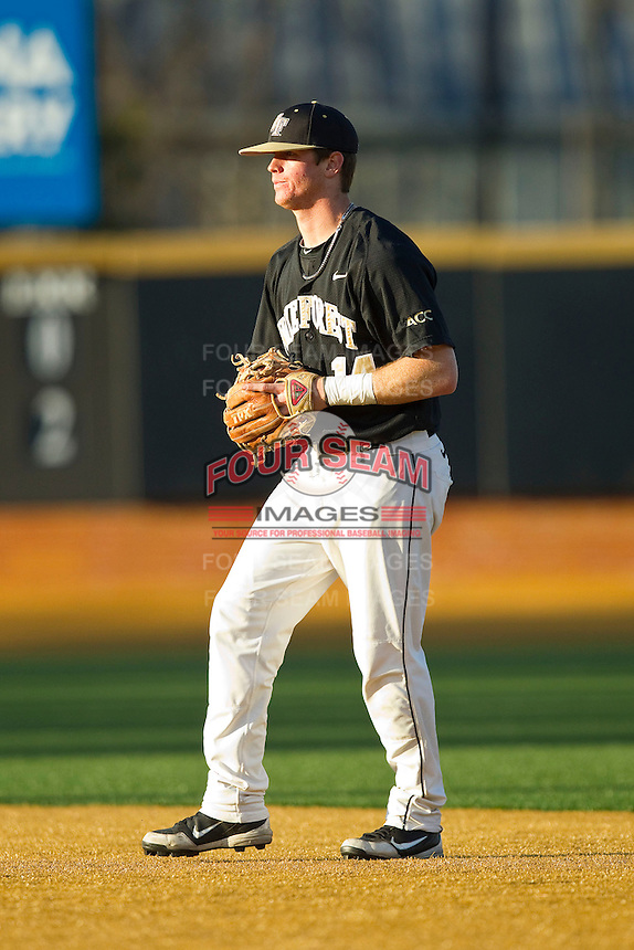 Wake Forest Demon Deacons second baseman Conor Keniry (14) on defense against the North Carolina Tar Heels at Wake Forest Baseball Park on March 9, 2013 in Winston-Salem, North Carolina.  The Tar Heels defeated the Demon Deacons 20-6.  (Brian Westerholt/Four Seam Images)