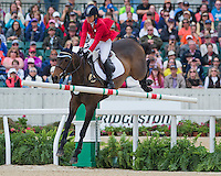 SYD KENT, ridden by Jan Byyny (USA), competes during Stadium Jumping at the Rolex 3-Day Event at the Kentucky Horse Park in Lexington, Kentucky on April 28, 2013.