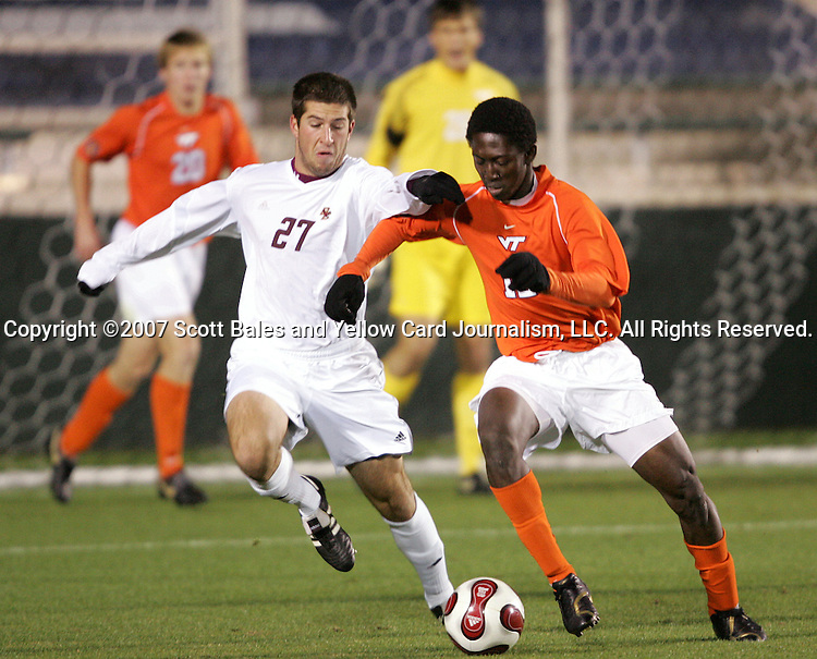 16 November 2007: Boston College's Jamie Melas (27) challenges Virginia Tech's Patrick Nyarko (right) for the ball. Boston College defeated Virginia Tech 3-1 at SAS Stadium in Cary, NC in an Atlantic Coast Conference Men's Soccer tournament semifinal.