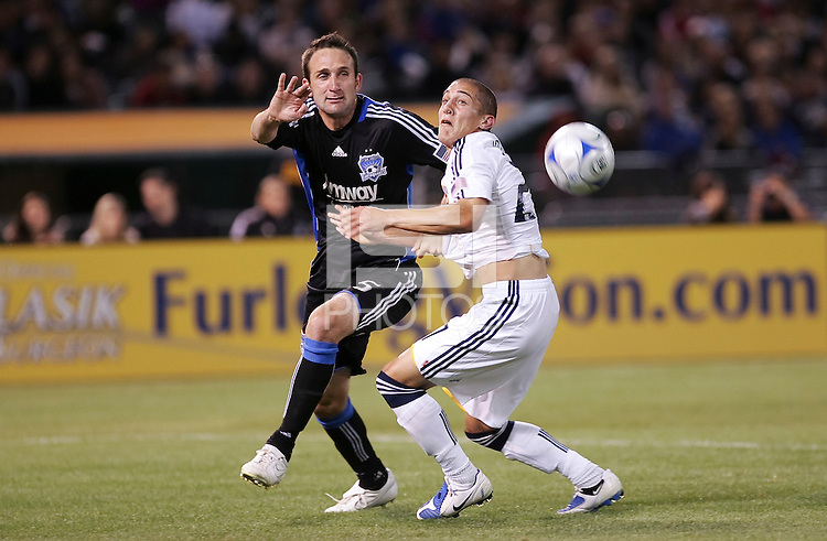 Ryan Cochrane (5) battles against Bryan Jordan (right). San Jose Earthquakes tied Los Angeles Galaxy 1-1 at the McAfee Colisum in Oakland, California on April 18, 2009.