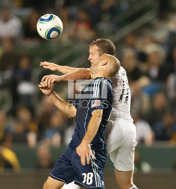 CARSON, CA – May 14, 2011: Sporting KC defender Aurelien Collin (78) and LA Galaxy forward Chad Barrett (11) go high during the match between LA Galaxy and Sporting Kansas City at the Home Depot Center in Carson, California. Final score LA Galaxy 4, Sporting Kansas City 1.
