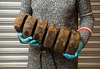 BNPS.co.uk (01202 558833)<br /> Pic: PhilYeomans/BNPS<br /> <br /> Wooden 'Tampions' used to seal and protect gun barrels.<br /> <br /> Fascinating artefacts salvaged from a historic gun ship which sunk off the British coast 261 years ago have gone on display for the first time.<br /> <br /> The French built ship is credited with transforming the Georgian Royal Navy after its capture in 1747 when trials revealed it was sleeker and better armed than British warships of the day.<br /> <br /> Unfortunately HMS Invincible  became wrecked on a shallow sand bank in the Solent in 1758 when en route to fhelp fight the French in Canada.<br /> <br /> The wreck, which is three nautical miles from Portsmouth, Hants, was first discovered by a fisherman in shallow 25ft waters 40 years ago. However, changing sea bed levels in the past few years have left it more exposed to the elements, leading to fears the relics could deteriorate.<br /> <br /> This prompted archaeologists to carry out a full scale excavation, with 1,458 dives taking place between 2017 and 2019 - during which nearly 2,000 artefacts were recovered.<br /> <br /> The array of new finds, including the ship's enormous cutwater - the forward curve of the ship's stem - have now been unveiled at the MAST Archaeological Centre in Poole, Dorset. They will eventually go on display at the National Museum of the Royal Navy in Portsmouth.<br /> <br /> Mr Pascoe said the HMS Invincible's innovative longer, streamlined design was copied by the British who adopted it on their ships up until the Battle of Trafalgar (1805).