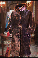 BNPS.co.uk (01202 558833)<br /> Pic: HAldridge/BNPS<br /> <br /> A fur coat which helped keep a Titanic survivor warm in the aftermath of the disaster that was unearthed 105 years later - has sold for a staggering &pound;181,000.<br /> <br /> Mabel Bennett, a first class stewardess on the doomed liner, grabbed the thick garment from her room before climbing into a lifeboat as the ship gradually sank in the icy Atlantic.<br /> <br /> Mabel still had the coat with her days later when she was photographed wearing it while on board the SS Lapland, the ship that took all the surviving Titanic crew members back to England.<br /> <br /> Mabel, from Southampton, kept the beaver lamb sheepskin coat for the next 50 years until she gave it to her great niece because it became too heavy for her to wear in her old age.