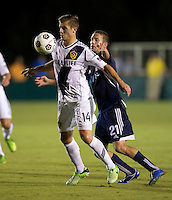 Robbie Rogers (14) of the LA Galaxy controls the ball in front of Brian Shriver (21) of the Carolina Railhawks during a third round match in the US Open Cup at WakeMed Soccer Park in Cary, NC.  The Carolina Railhawks defeated the LA Galaxy, 2-0.