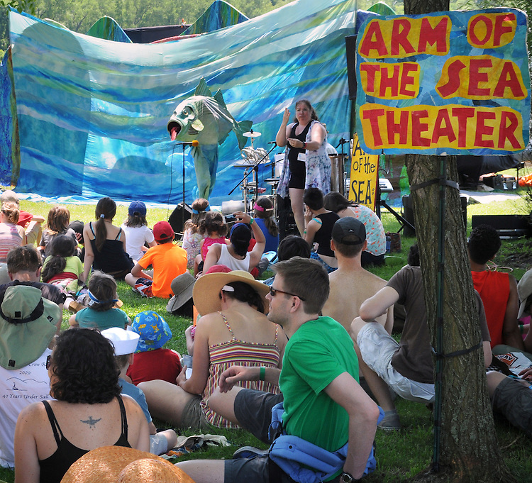 """Sign Language Interpreter, Luane Davis Haggerty, translating the words of, Arm-of-the-Sea Mask and Puppet Theater troupe, performing """"The Rejuvenary River Circus,""""  near the river's edge, on the first day of the Clearwater's Great Hudson River Revival Festival 2013, held at Croton Point Park, in Croton-on-Hudson, NY, June 15, 2013. Photo by Jim Peppler. Copyright Jim Peppler 2013 all rights reserved."""