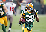 Green Bay Packers defensive back Tramon Williams (38) returns an interception during a Week 11 NFL football game against the Tampa Bay Buccaneers on November 20, 2011 in Green Bay, Wisconsin. The Packers won 35-26. (AP Photo/David Stluka)